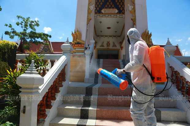 A worker sprays disinfectant at the cremation hall at Wat Bang Ping in Muang district of Samut Prakan on May 24, 2021 after the body of a Covid-19 victim was burned. (Photo by Somchai Poomlard)