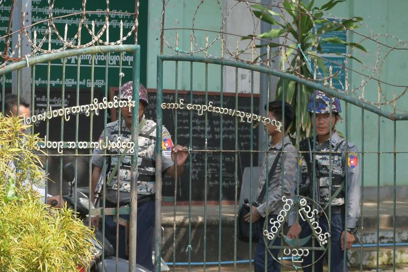 Armed police are posted at the entrance of a school in Sittwe, capital of western Rakhine State on June 1, 2021. (AFP photo)