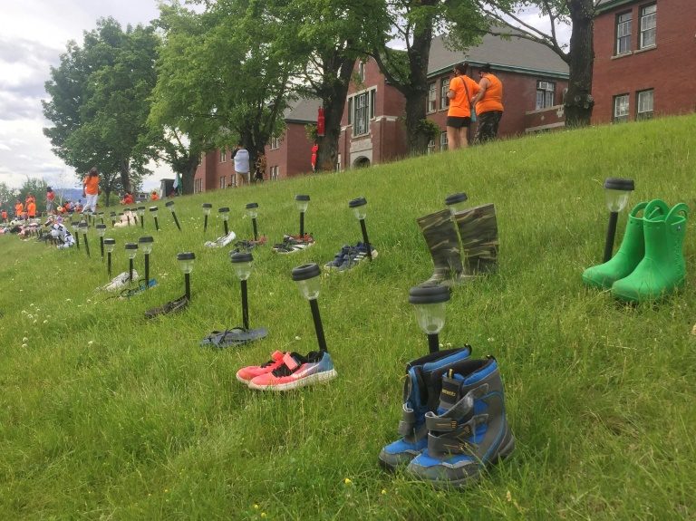 Shoes are left in tribute at the Kamloops Indian Residential School, where the remains of 215 children have been found