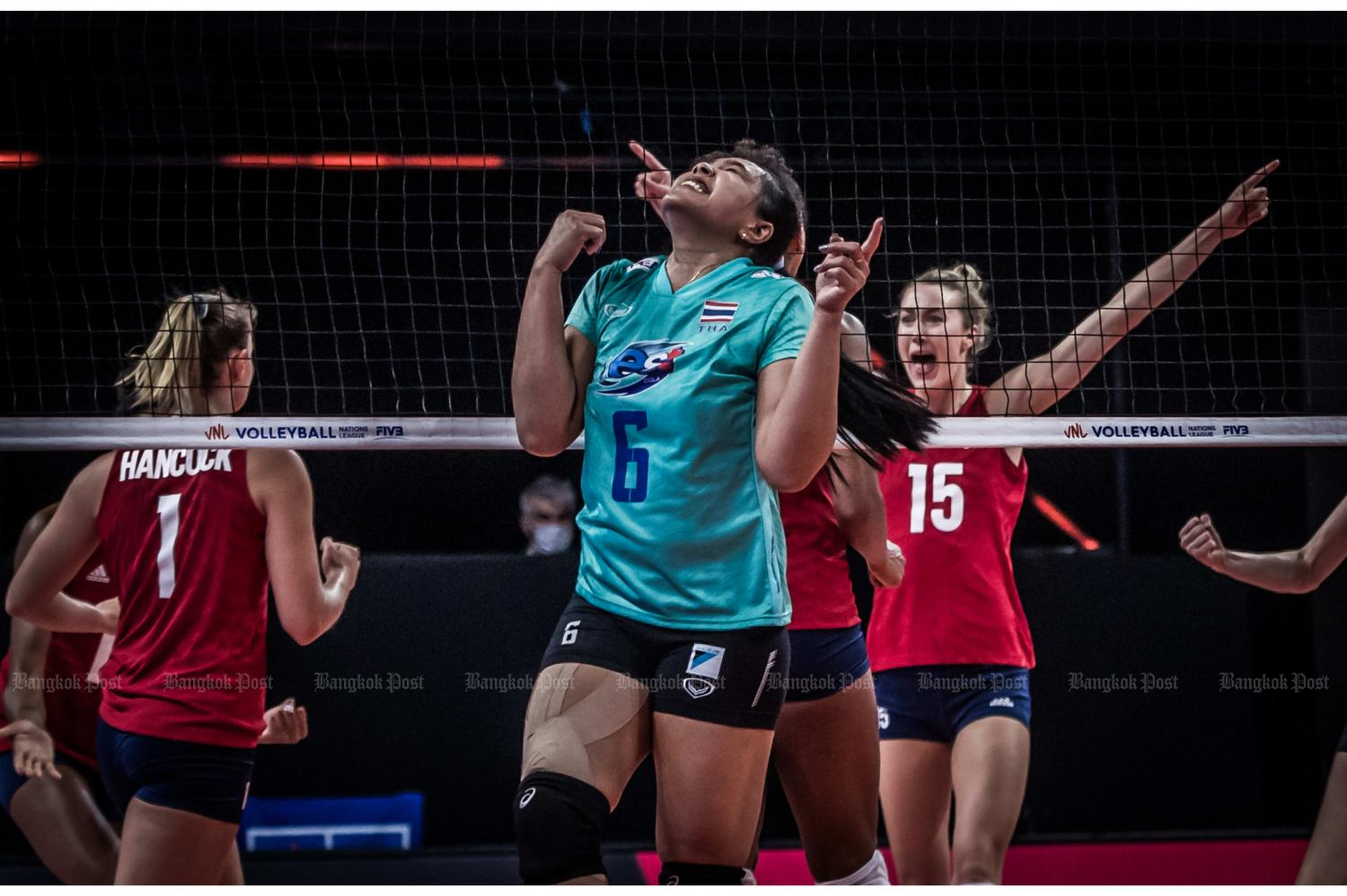 Thailand's Onuma Sittirak, No.6, reacts as US players celebrate a point during their Nations League match in Italy on Wednesday.(FIVB photo)