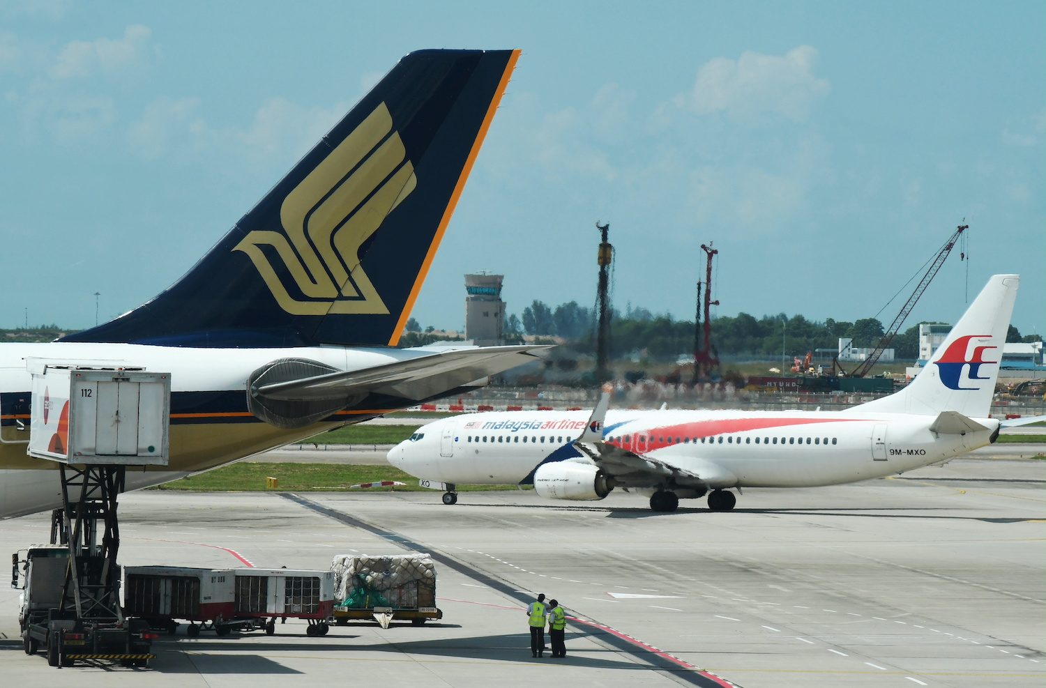 Malaysia Airlines and Singapore Airlines planes are pictured at Changi Airport in Singapore in July 2019. (Reuters File Photo)