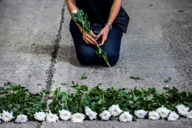 An artist in Hong Kong mourns the victims of China's deadly Tiananmen Square crackdown after authorities banned an annual vigil and vowed to stamp out any protests on the June 4 anniversary.