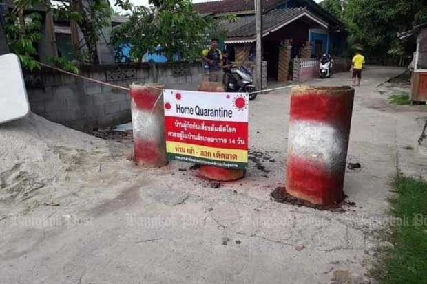 A banner is put up at an entrance to a village in Koh Sathon in Narathiwat. It announces the community is under home quarantine after the first infections of the so-called Beta (South African) variant of Covid 19 were recorded there. (Photo by Abdullah Benjakat)