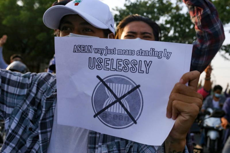 A protester against Myanmar's junta holds a placard criticising the Association of Southeast Asian Nations in Mandalay, Myanmar, on Saturday. (Reuters photo)