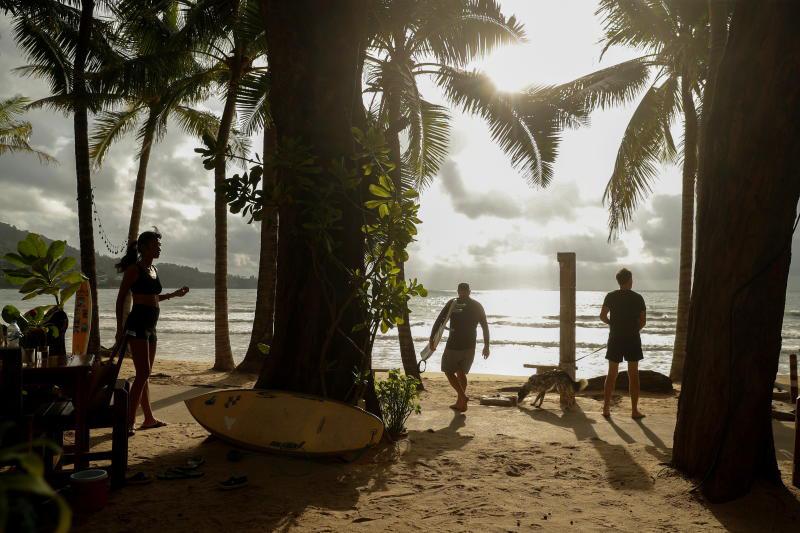 Local residents enjoy Kamala beach on Phuket island on April 2, 2021. (Reuters photo)