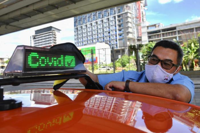 Bangkok cabbie hopes to capitalise on his Covid-19 shot