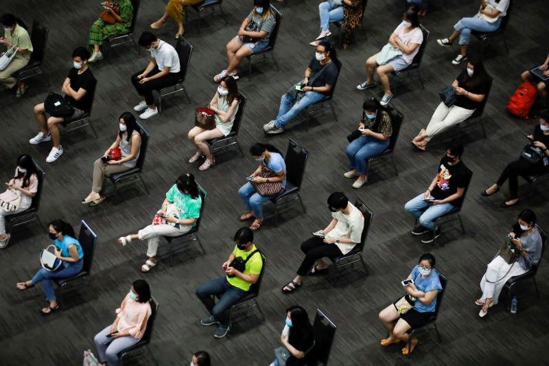 People wait to receive their first dose of AstraZeneca vaccine at Siam Paragon shopping centre in downtown Bangkok on Monday. (Photo: Reuters)