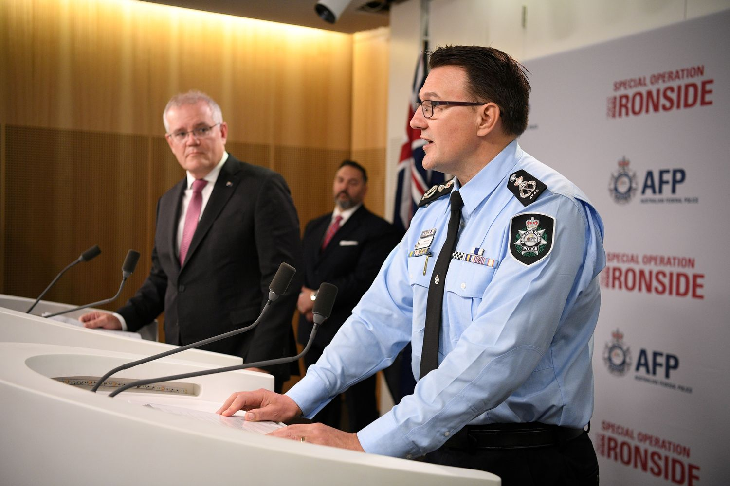 Australian Federal Police Commissioner Reece Kershaw speaks as Australian Prime Minister Scott Morrison looks on during a media briefing about Operation Ironside, which disrupts organised crime internationally, in Sydney on Tuesday. (AAP Image/Dean Lewins via Reuters)