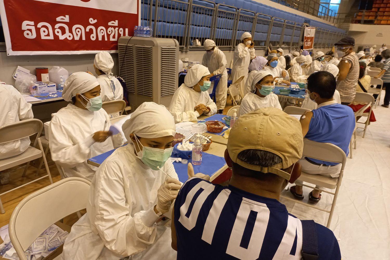 People get their Covid-19 vaccine shots at Vachira Hospital in Phuket on Monday. (Photo by Achadtaya Chuenniran)
