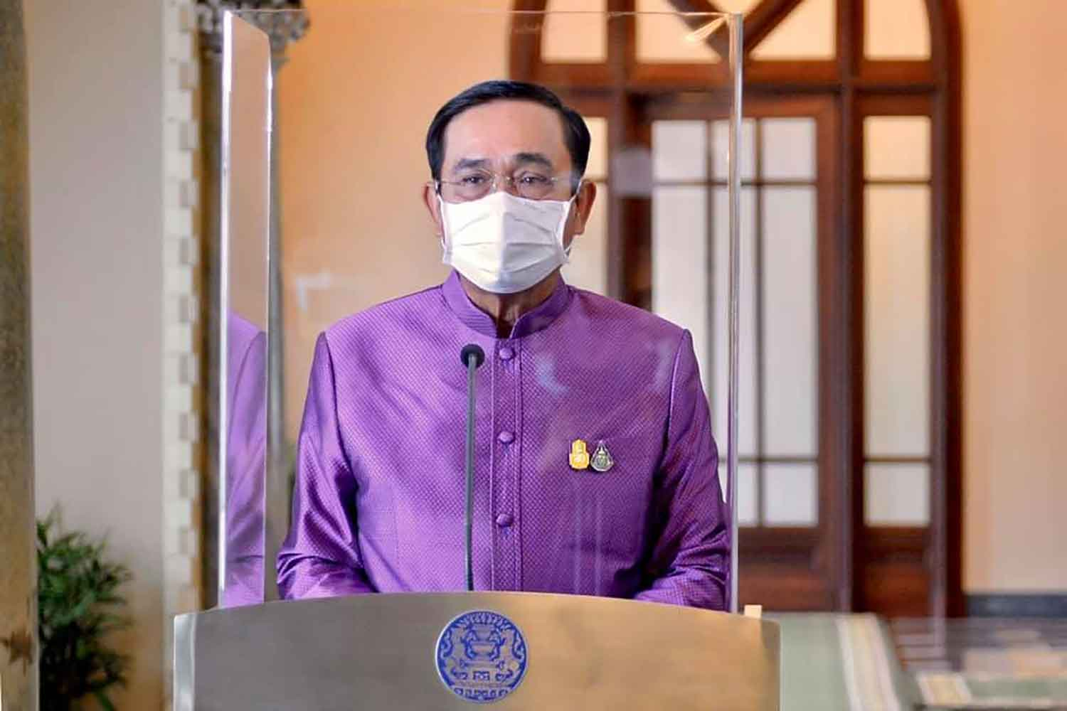 Prime Minister Prayut Chan-o-cha speaks to reporters at Government House in Bangkok on Tuesday. (Government House photo)