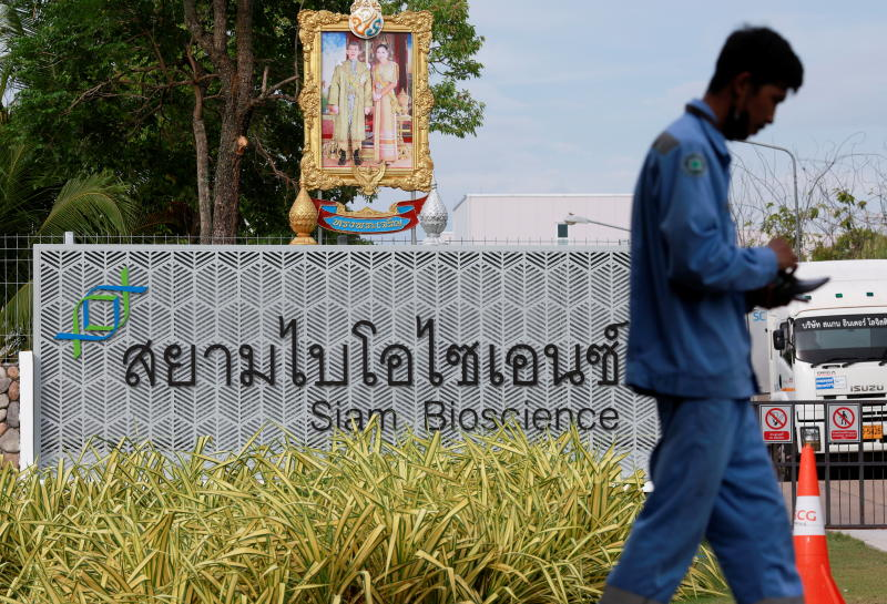 FILE PHOTO: A man walks in front of the Siam Bioscience factory, where the vaccine against the coronavirus disease (Covid-19) will be produced in Nonthaburi on June 3, 2021. (Reuters photo)