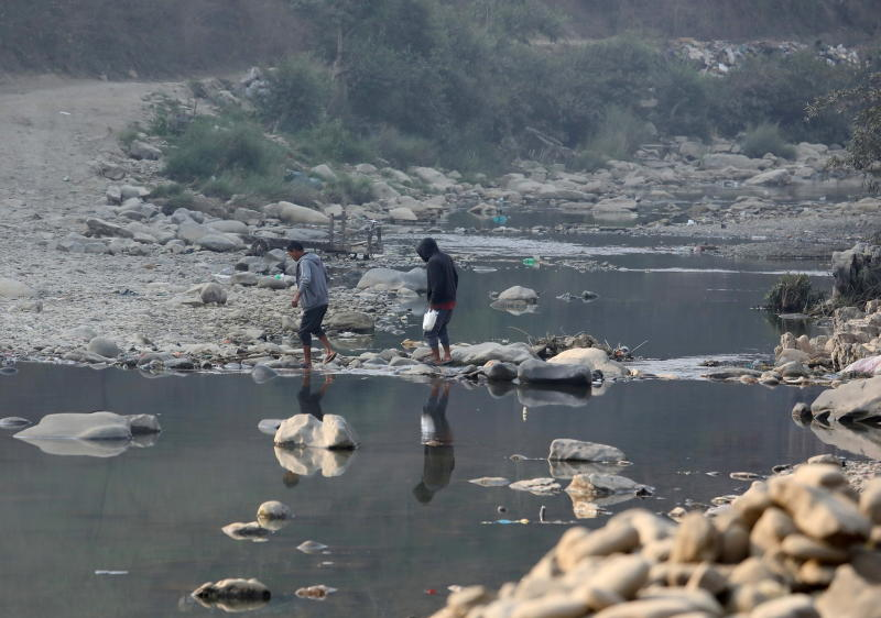 FILE PHOTO: People cross the Tiau river which marks the India-Myanmar border at Zokhawthar village in India's northeastern state of Mizoram, India, March 12, 2021. (Reuters)