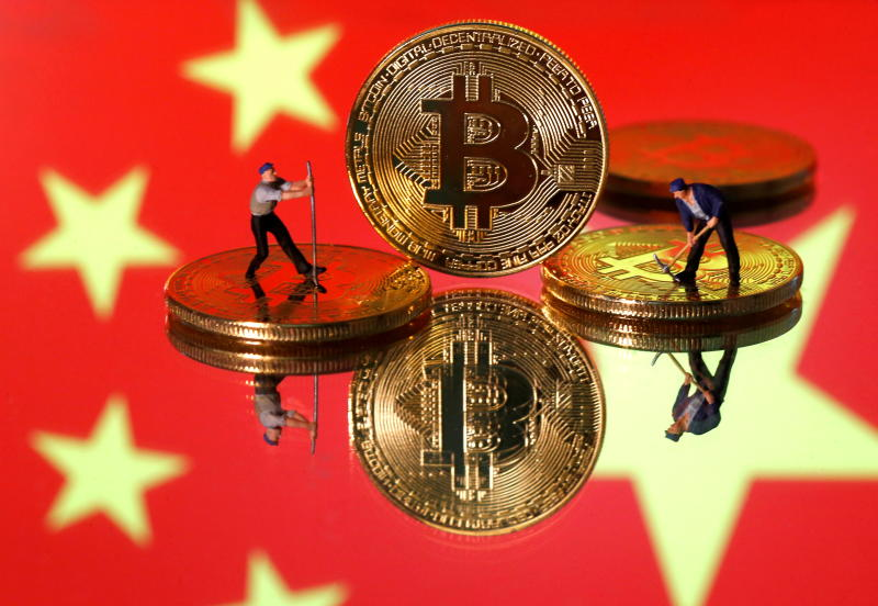 FILE PHOTO: Small toy figurines are seen on representations of the Bitcoin virtual currency displayed in front of an image of China's flag in this illustration picture, April 9, 2019. (Reuters)