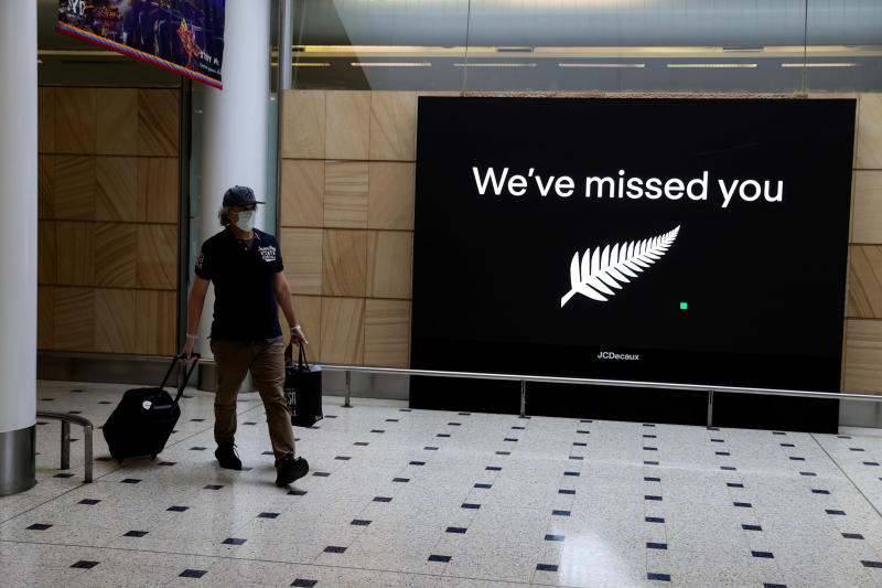 FILE PHOTO: A passenger arrives from New Zealand after the Trans-Tasman travel bubble opened overnight, following an extended border closure due to the coronavirus disease  outbreak, at Sydney Airport in Sydney, Australia, Oct 16, 2020. (Reuters)