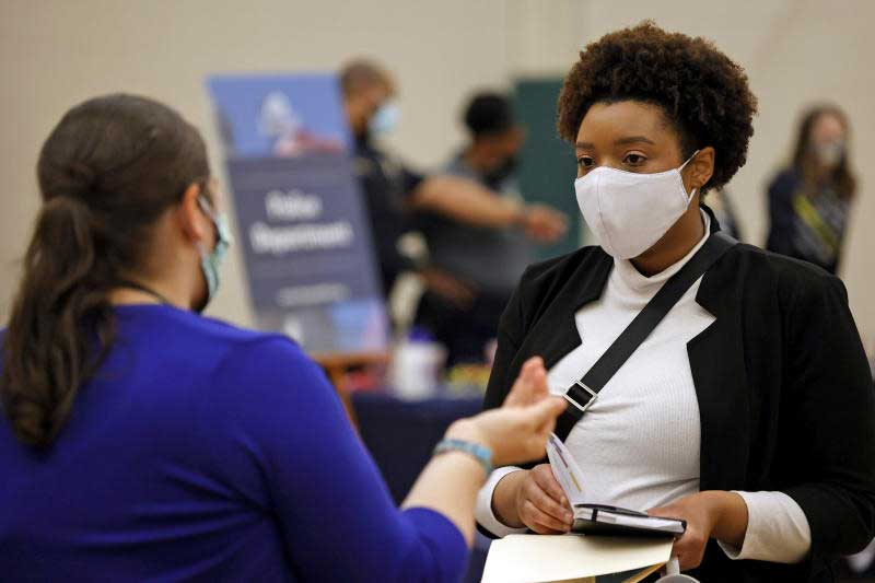 A woman speaks with a potential employer during a job fair at Hembree Park in Roswell, Georgia, the United States on May 13, 2021. (Reuters photo)