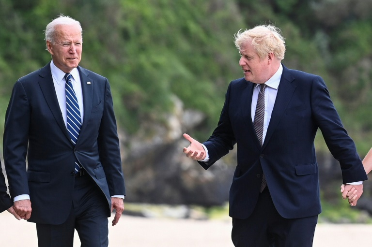 President Biden (left) will attend the G7 summit, on his first foreign trip, along with host Boris Johnson, seen here in Cornwall on Thursday.