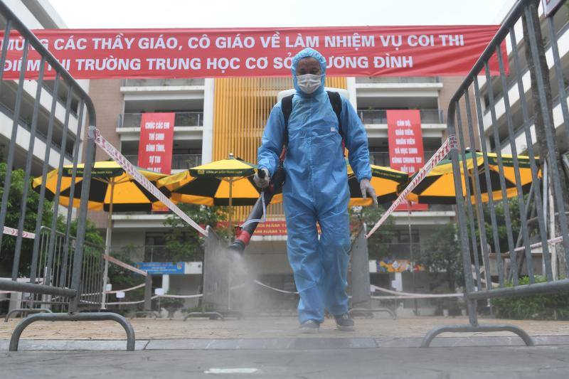 A health worker disinfects a secondary school as part of measures to halt the spread of the Covid-19 coronavirus in Hanoi on Friday. (AFP photo)