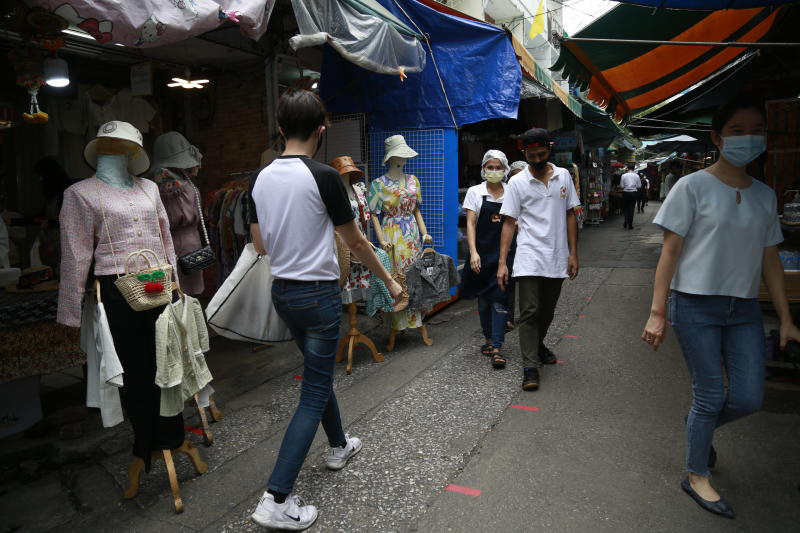 Shoppers return to a market on Soi Lalai Sap off Silom road in Bangkok on Monday. The market was closed for disinfection on Thursday.  (Photo by Arnun Chonmahatrakool)