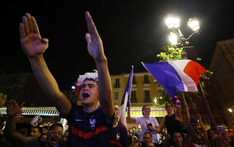French fans celebrate after watching the France-Germany match on a screen in Nice on Tuesday. (Reuters photo)