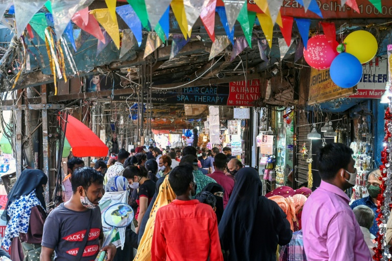Crowds shop at a market in New Delhi after lockdown curbs are eased.