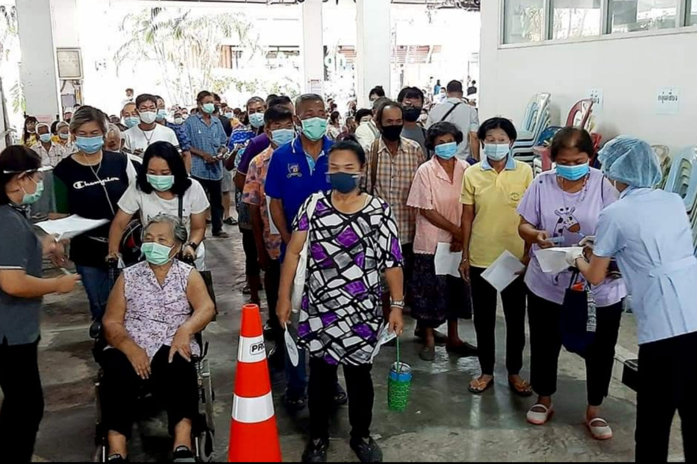 People wait for Covid-19 vaccination in Prachuap Khiri Khan's Muang district. (Photo: Chaiwat Satyaem)
