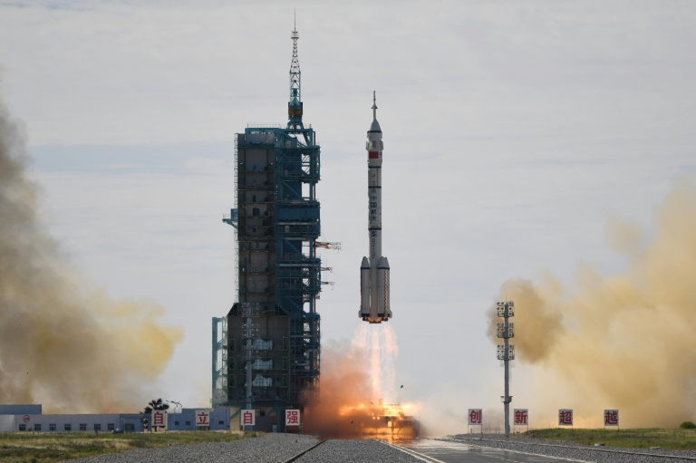 A Long March-2F carrier rocket, carrying the Shenzhou-12 spacecraft and a crew of three astronauts, lifts off from the Jiuquan Satellite Launch Centre in the Gobi desert, in northwest China.