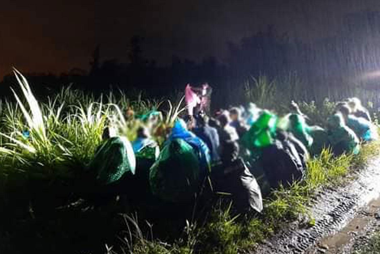 Myanmar border crossers sneak across river during heavy rain