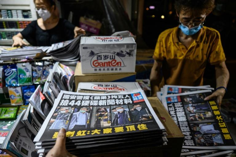 Hong Kong democracy paper runs defiant edition day after raid