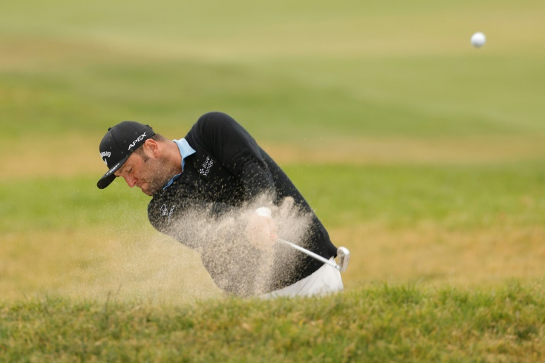 Rahm grinds his way into title hunt at US Open