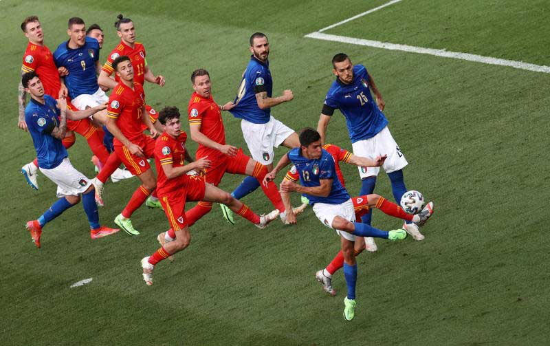 Italy's Matteo Pessina scores their first goal against Wales on Sunday. (Reuters photo)