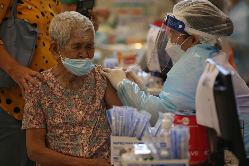 A woman gets her first AstraZeneca dose at Bhumibol Adulyadej Hospital in Sai Mai district of Bangkok on Monday. (Photo by Varuth Hirunyatheb)