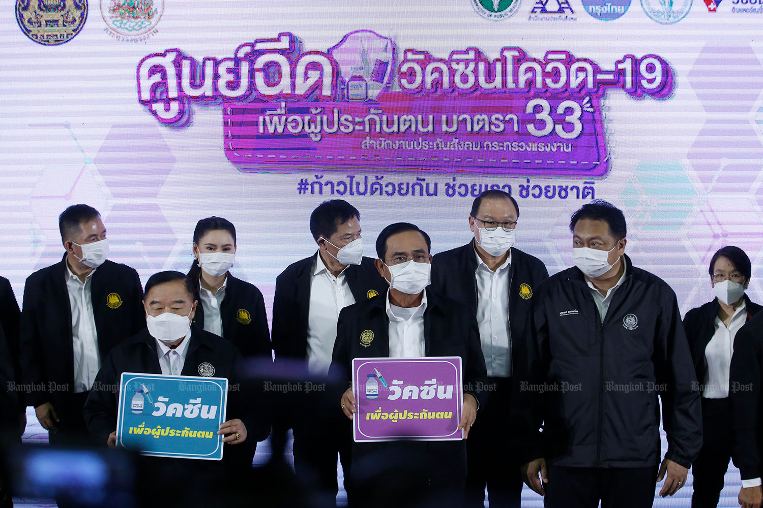 Prime Minister Prayut Chan-o-cha and others visit a Covid-19 vaccination centre at the Thailand-Japan sports stadium, Din Daeng district, Bangkok on June 7. (Photo: Wichan Charoenkiatpakul)