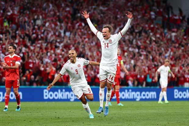 Denmark's players celebrate after their first goal on Monday. (Reuters photo)