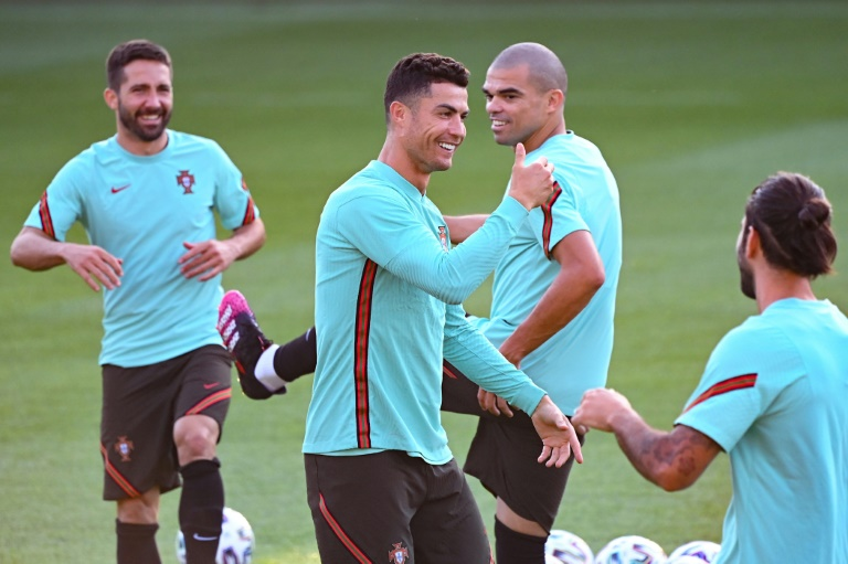 Cristiano Ronaldo and Portugal are at risk of early elimination when they play France in Budapest.