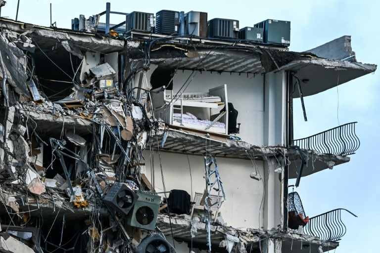 One dead, dozens unaccounted for in Florida apartment block collapse
