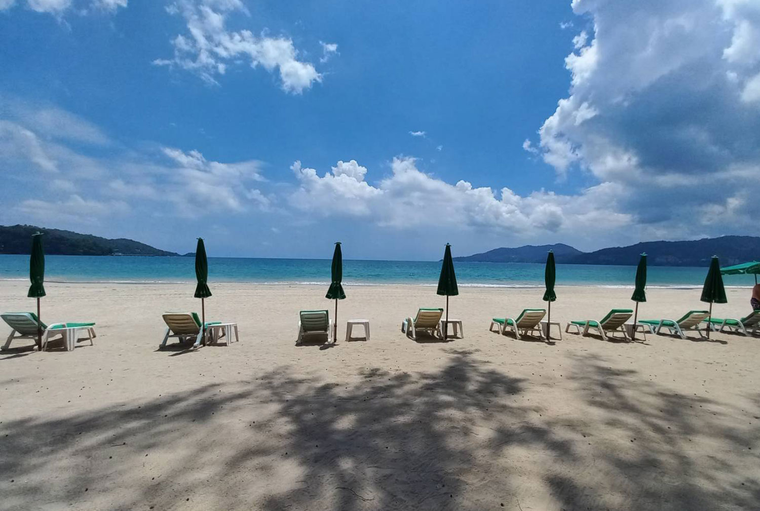 Empty chairs on Patong beach in Phuket may be filled with foreign tourists after the island province reopens next Thursday. (Photo: Achadthaya Chuenniran)