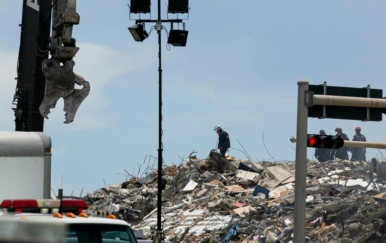 Rescue personnel continue to search the rubble at the site of a collapsed building in Surfside, Florida, north of Miami Beach, on June 26, 2021.