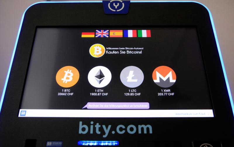 The exchange rates and logos of Bitcoin (BTH), Ether (ETH), Litecoin (LTC) and Monero (XMR) are seen on the display of a cryptocurrency ATM of blockchain payment service provider Bity at the House of Satoshi bitcoin and blockchain shop in Zurich on Friday. (Reuters photo)