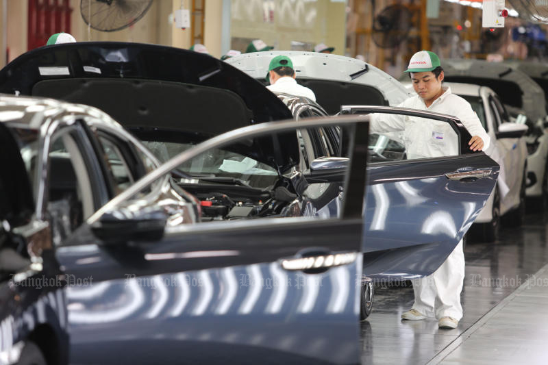 Staff work at an auto assembly plant in Prachin Buri. The auto industry is a key driver for the economy. (Bangkok Post file photo)