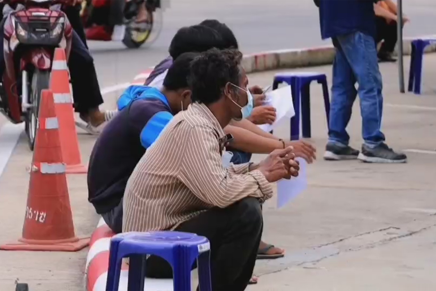 Workers wait their turn to be tested for Covid-19 in Muang district of Nakhon Ratchasima on Sunday. (Photo: Prasit Tangprasert)