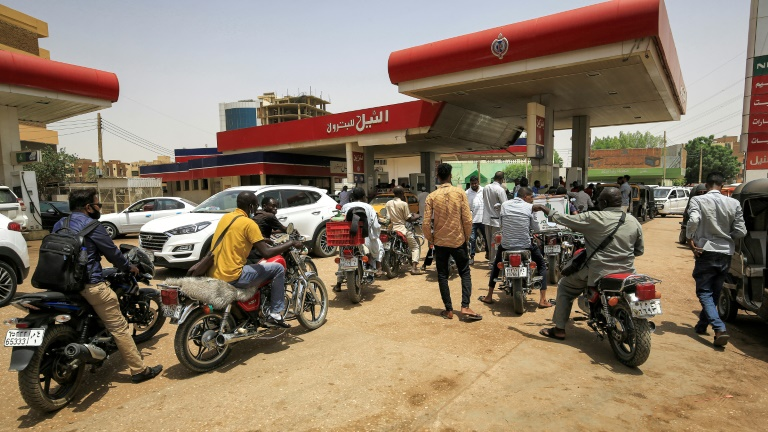 Motorcyclists queue-up for fuel at a petrol station in Sudan's capital Khartoum on June 10, 2021. Sudan has ended fuel subsidies as part of an IMF-backed reform programme, helping it secure a $2.5 billion loan from the financial institution.