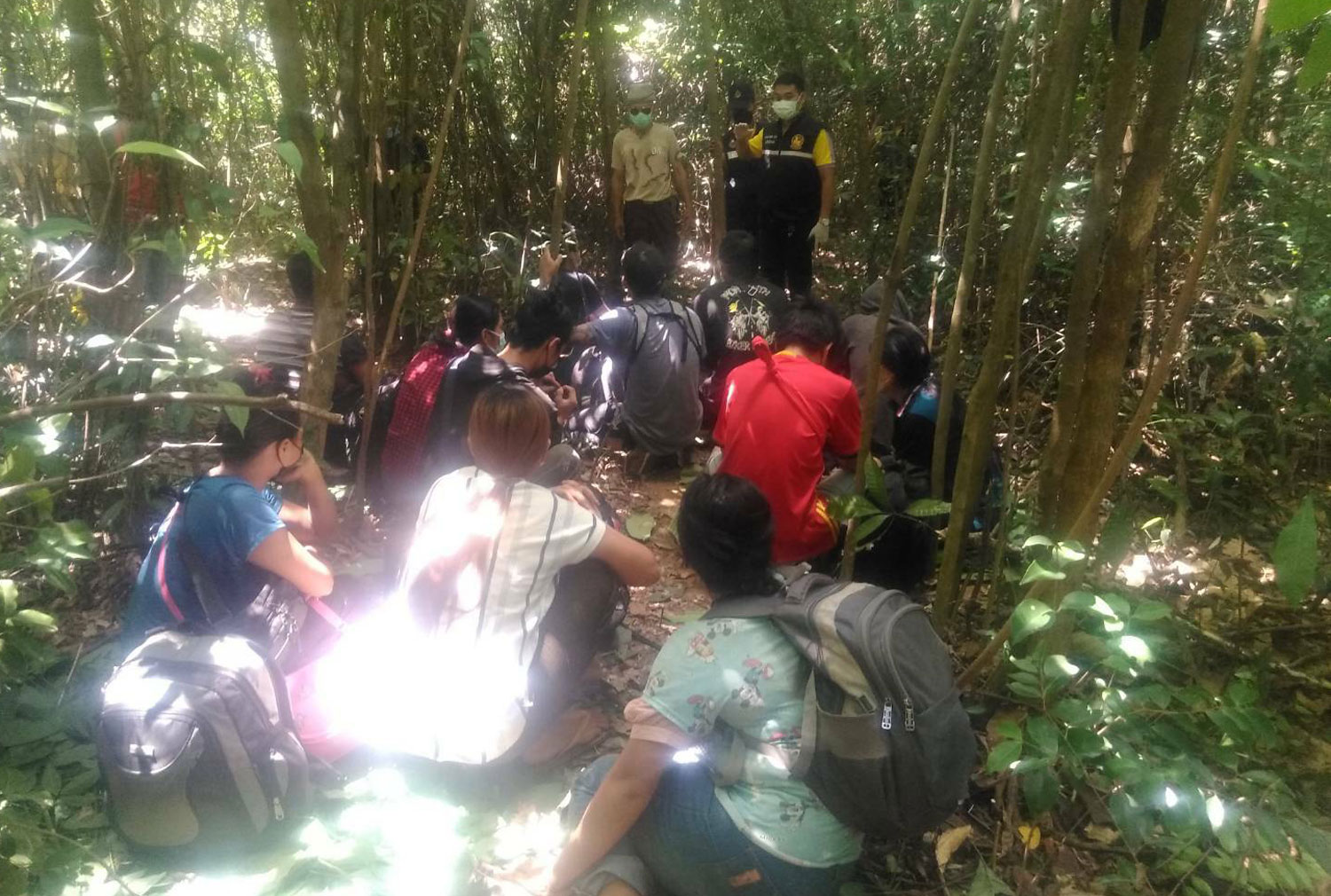 A group of 12 Myanmar nationals, including a guide, is found in a forested area in Songkhla's Bang Klam district on Thursday morning. (Photo: Assawin Pakkawan)