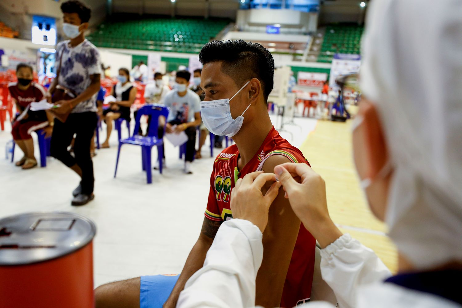 A member of the armed forces in parliament receives the AstraZeneca Covishield coronavirus vaccine in Naypyitaw, Myanmar, on Jan 30 this year. (Reuters photo)