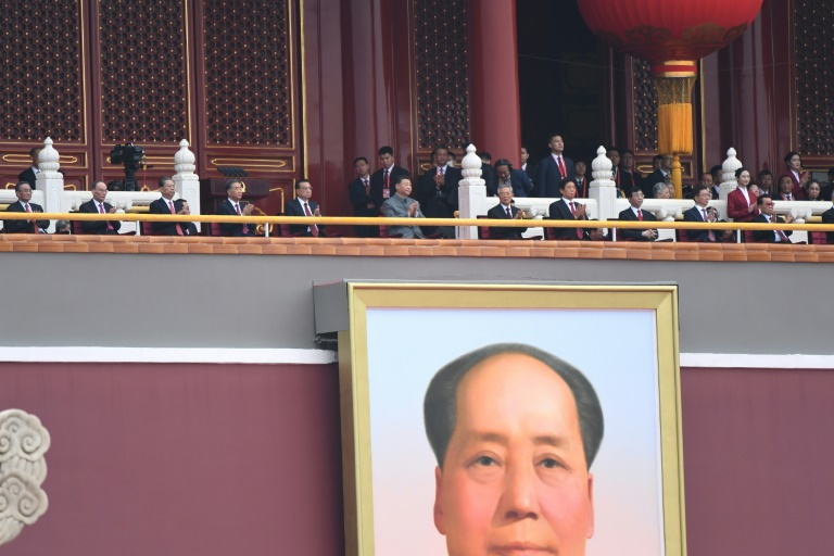 Chinese President Xi Jinping (centre) attends the celebration of the 100th anniversary of the founding of the Communist Party of China at Tiananmen Square in Beijing.