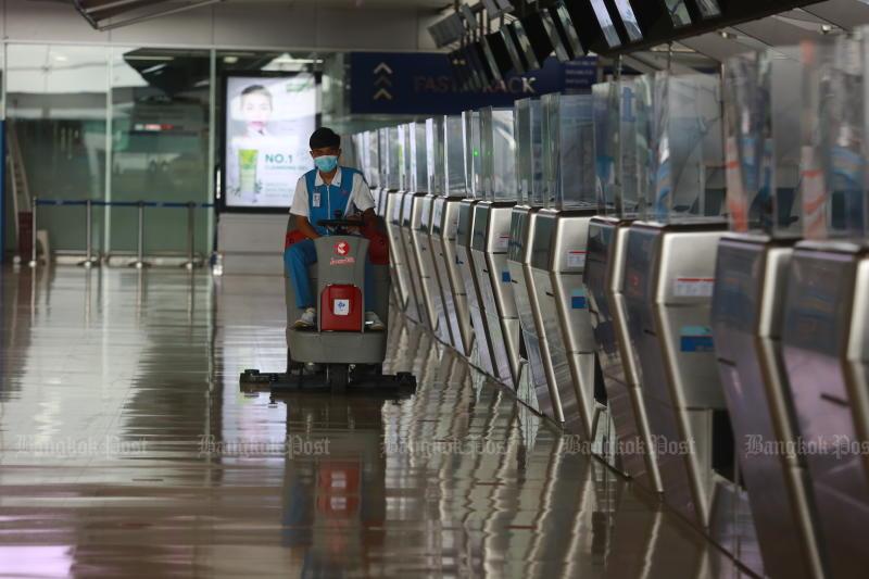 A worker cleans Suvarnabhumi airport on May 28, 2021. (Photo: Somchai Poomlard)