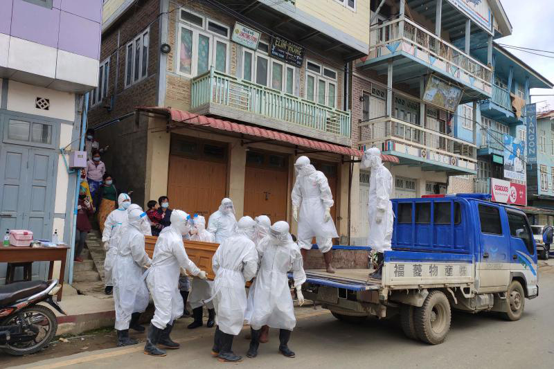 Health workers carry a coffin bearing the remains of a Covid-19 coronavirus victim who died at home in Tedim, western Chin state, as more than 2 million people in Myanmar were placed under new stay-at-home measures on Friday. (Tedim Post/AFP photo)