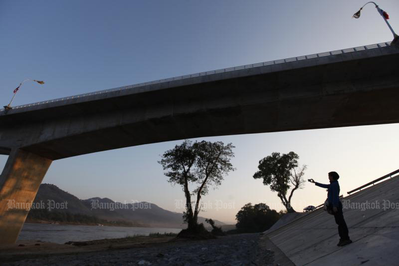 A planned new expressway in northern Laos will link with Thailand via the bridge over the Mekong River in Chiang Khong district of Chiang Rai. (Bangkok Post photo)