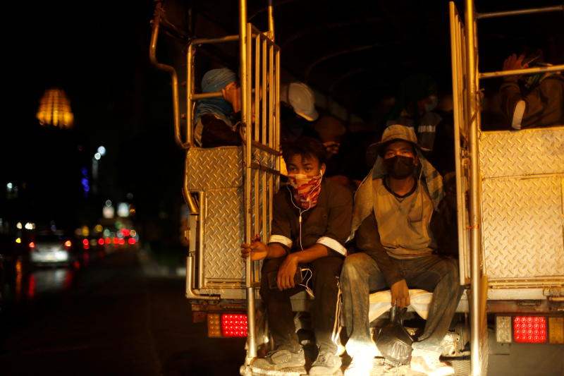Migrant construction workers are transported in a truck amid the coronavirus outbreak in Bangkok on May 27, 2021. (Reuters photo)