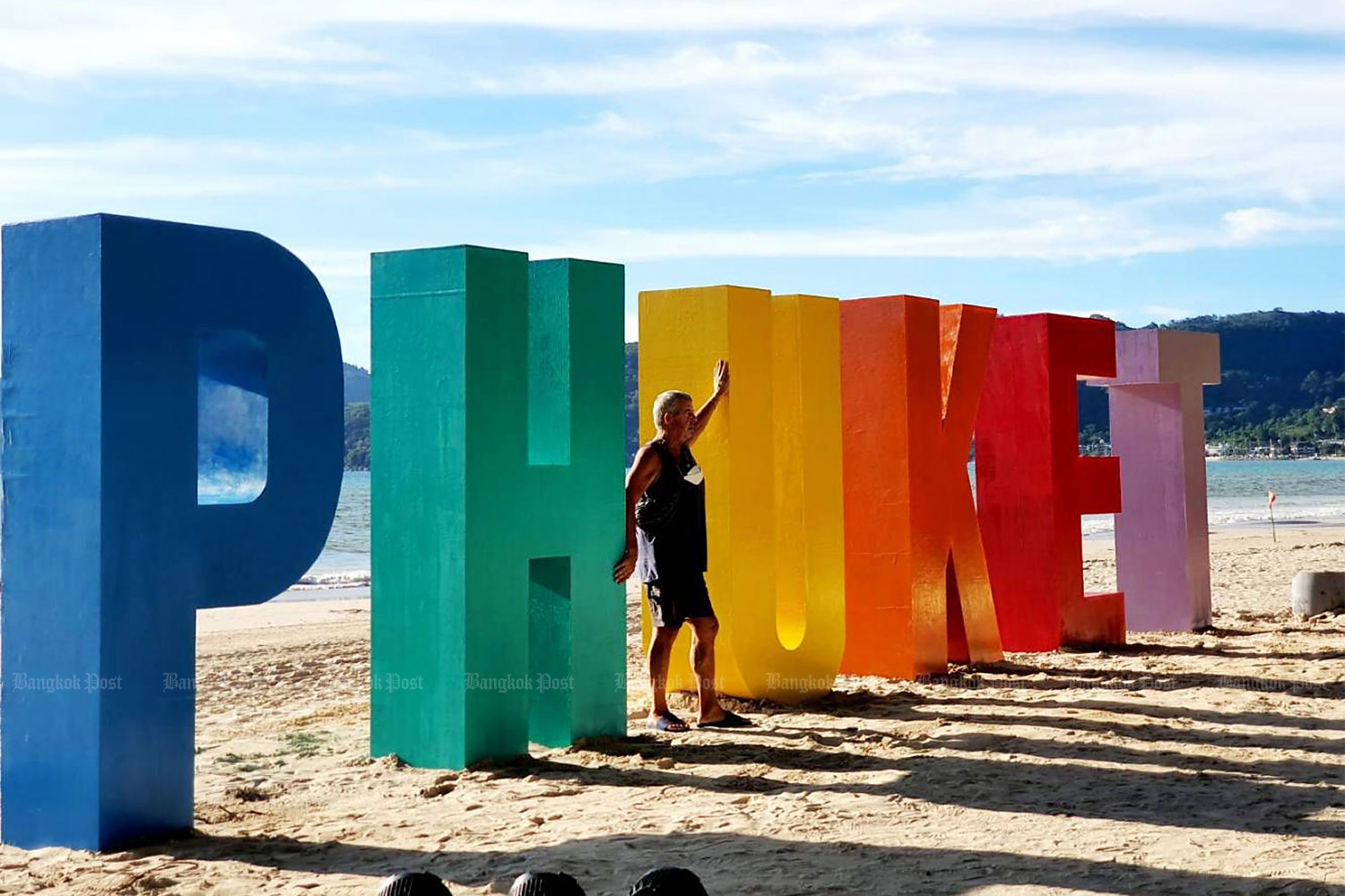 A tourist poses for a photograph in Phuket. The island reopened to international tourists following several months of travel restrictions due to Covid-19.