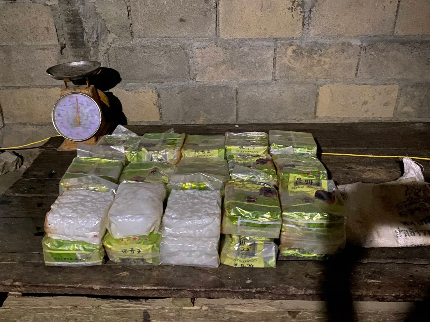 Packs of crystal methamphetamine found in a room beneath a woman's house in Pattani's Sai Buri district on Thursday night. (Photo: Abdullah Benjakat)